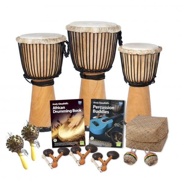 This is a product image of the African Drumming - Secondary - 10 Player Starter Pack. The products in the pack are laid out and include the following; Back Row - One Djembe Drum - Standard - 10.5in diameter, 60cm high, natural, one Djembe Drum - Standard - 12in diameter, 65cm high, natural, one Djembe Drum - Standard - 9in diameter, 50cm high, natural. Second Row - Andy Gleadhill's African Drumming Book 1, Andy Gleadhill's Percussion Buddies Book, Storage Basket. Front Row - Two Seseh - Coconut Shakers, three Agogo - natural, two Caxixi Basket Shakers.