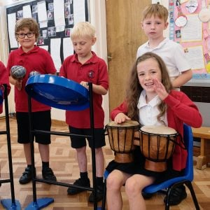 This is an action shot of some Primary School children playing with Bongos (African Bongos), a Jumbie Jam Steel Pan and some shakers.