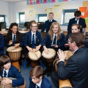 This is an action shot of some Secondary School students playing Djembes and other West African instruments at a music workshop.