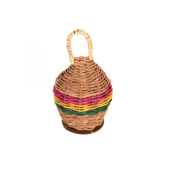 This is a product image of a Caxixi Basket Shaker. It is a woven wicker basket that is competely enclosed with a handle at the top. It has been painted around the circumference in pink, yellow and green.