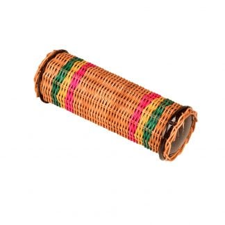 This is a product image of the Caxixi - Cylinder. It is a wicker woven tube that is sealed at either end. It has two painted sections in green, yellow and pink. The instrument is laid flat and angled from top left to bottom right.