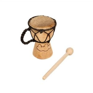 This is a product image of the Djembe Drum - Budget - 2in diameter, 12cm high, Early Years from the side, showing the wood burnt image on the shell. The beater is lying next to it.