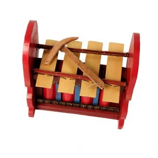 This is a product image of the Gamelan - Budget - Large 4 key. The instrument has four gold keys suspended by bamboo and wire. The casing is mainly red with some blue, gold and black decoration. A beater is laying on top of the instrument. The image has been taken from above and in front, with the instrument facing slightly to the left.
