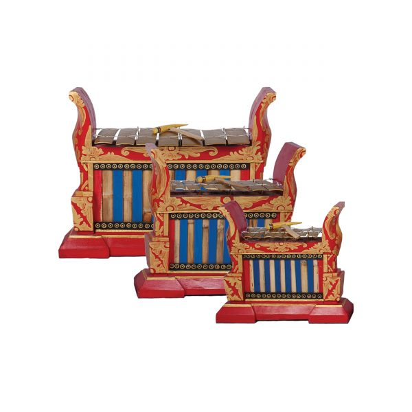 This is a product image of the Gamelan - Premium - 7 key - 3 Pack. The three instruments are red and blue with gold keys suspended from wire and each with a beater resting on the bars. The image is head on and from the rear to the front are the Gamelan - Premium - Large 7 key, Gamelan - Premium - Medium 7 key and Gamelan - Premium - Small 7 key.