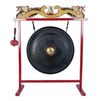 This is a product image of the Gong Set - 32in (80cm) diameter Gong with Stand and Beater. The frame is a sleek metal design, painted red with a two ornate wooden dragons in red white and gold, sitting on the crossbar. The Gong is matt black with a gold boss and is hanging evenly from two hooks. The beater is attached to a hook on the left hand side of the stand. The image has been taken from a head on position.