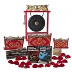 This is a product image of the Indonesian Gamelan - Standard - 15 Player Class Pack - Budget Buddies. The products are laid out and include the following; Back Row - One Gong Set - 20in (50cm) diameter Gong with Stand and Beater. Second Row - One Gamelan - Standard - Medium 7 key, one Gamelan - Standard - Large 7 key, one Gamelan - Standard - Small 7 key. Front Row - One Balinese Drum - 50cm, Andy Gleadhill's Indonesian Gamelan Book, Andy Gleadhill's Percussion Buddies Book, Storage Basket, ten Ceng Ceng - 14cm, pair. Each instrument that requires a beater has one resting on top of them.
