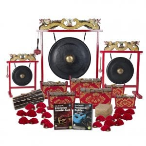 This is a product image of the Indonesian Gamelan - Standard - 20 Player Class Pack - Buddies. The products are laid out and include the following; Back Row - Gong Set - 12in (30cm) diameter Gong with Stand and Beater, Gong Set - 32in (80cm) diameter Gong with Stand and Beater, Gong Set - 20in (50cm) diameter Gong with Stand and Beater. Second and Third Rows - One Balinese Drum - 50cm, two Gamelan - Standard - Medium 7 key, two Gamelan - Standard - Large 7 key, two Gamelan - Standard - Small 7 key. Front Row - Andy Gleadhill's Indonesian Gamelan Book, Andy Gleadhill's Percussion Buddies Book, Storage Basket, ten Ceng Ceng - 14cm, pair. Each instrument that requires a beater has one resting on top of them.