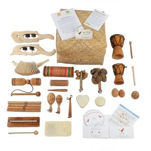Little Birdsong Treasure Basket - 22 Instruments, with the contents laid out flat outside of the basket.