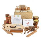 This is a product image of the Little Birdsong Treasure Basket - 22 Instruments. All of the varied instruments are placed on or around the Storage Basket, with the CD and cards leaning upright.
