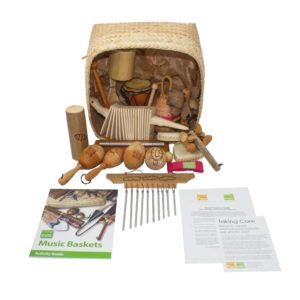 This is a product image of the Little Hands Basket - 15 Instruments. All of the varied instruments are placed on or around the Storage Basket, with the guides and cards laid in front.