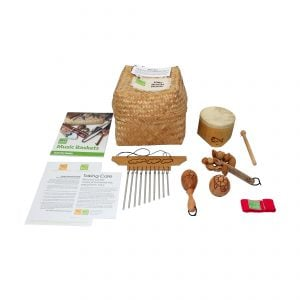 Little Hands Starter Basket - 5 Instruments, with the contents laid out flat outside of the basket, include one Bamboo Mini Drum, one  Ball Shaker - 5cm, Early Years - Early Years, one Wind Chime - Early Years, one Kenari Shaker - Early Years, one Music Bracelet - XS, one Egg on Stick - Small - 5cm, Early Years.