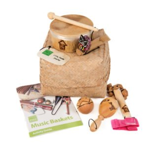 This is a product image of the Little Hands Starter Basket - 5 Instruments. All five instruments are stacked together and include one Bamboo Mini Drum, one  Ball Shaker - 5cm, Early Years - Early Years, one Wind Chime - Early Years, one Kenari Shaker - Early Years, one Music Bracelet - XS, one Egg on Stick - Small - 5cm, Early Years.