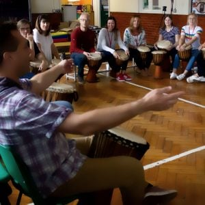 Image showing of Andy Gleadhill's African Drumming workshop, participants sit in circle.