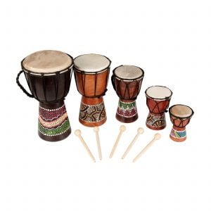 This is a product image of the Mixed Pack of 5 x Budget Djembe Drums - 12/15/20/25/30cm high, painted pack. The products included are laid out in a row and include the following; Djembe Drum - Budget - 6in diameter, 30cm high, painted. Djembe Drum - Budget - 5in diameter, 25cm high, painted. Djembe Drum - Budget - 4in diameter, 20cm high, painted. Djembe Drum - Budget - 3in diameter, 15cm high, painted. Djembe Drum - Budget - 2in diameter, 12cm high, painted. Each drum has a beater laid in front of it.