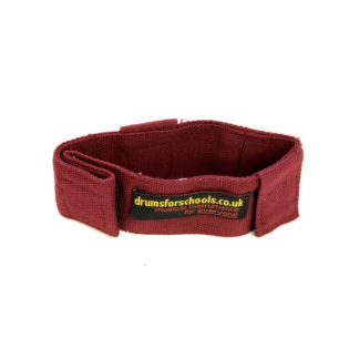This is a product image of the Music Bracelet - Large. It is red in colour and has a couple of Velcro loops for attaching shakers and other instruments.