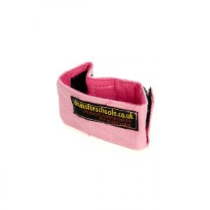 This is a product image of the Music Bracelet - XS. It is pink in colour and has a couple of Velcro loops for attaching shakers and other instruments.