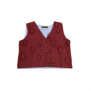 This is a product image of the Music Tunic - Large. It is laid out flat and is red in colour. There are lots of Velcro tab sections to attach various shakers.