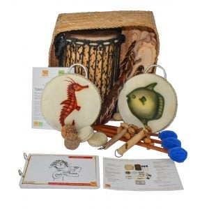 This is a product image of the Nursery Shaker Kit - 15 Instruments. The products are presented inside and around the Storage Basket with the documentation in front.