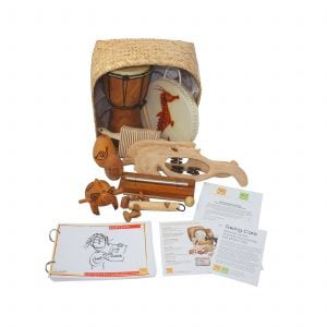 This is a product image of the Nursery Starter Kit - 10 Instruments. The products are presented inside and around the Storage Basket with the documentation in front.