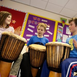 Image of Primary students playing Drums for School's African Drums