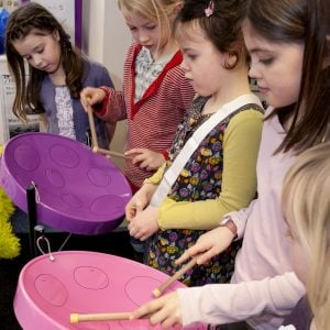 Image of Primary students playing Drums for School's Caribbean Steel Pan