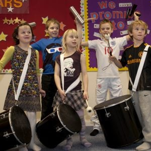 Image of Primary students playing Drums for School's Brazilian Samba