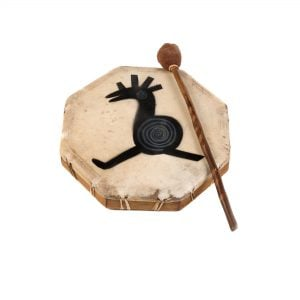 Shaman Drum - 12in (30cm) diameter, painted, with resting beater. It is an octaganal frame drum with a stretched goat skin. The skin has a tribal cockeral painted upon it. The beater is lying to the right.