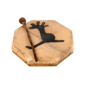 This is a product image of the Shaman Drum - 16in (40cm) diameter, painted. It is an octaganal frame drum with a stretched goat skin. The skin has a tribal cockeral painted upon it. The beater is lying upon the drum.
