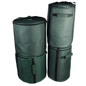 This is a product image of the Storage Carry Bags for 10 Brazilian Samba Secondary Big Drums. The bags are all green with straps for carrying, and the contents are accessed through a zipped top section on each. There are four bags - the left hand two are for the three nesting Surdo drums. The right hand bags will store a Caixa and Repinique each.