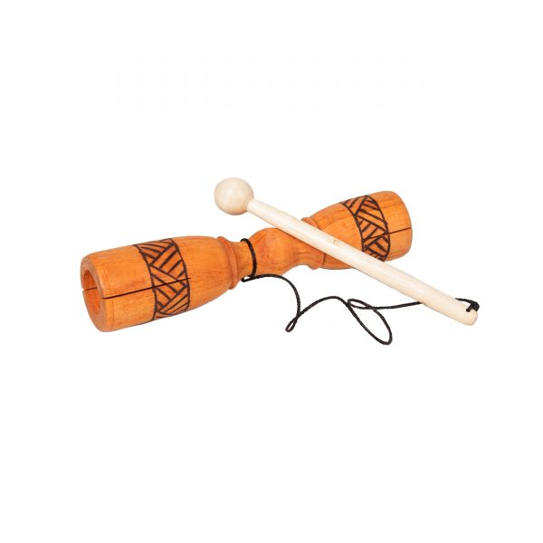 Tik Tok - carved. It is a carved piece of wood that is symmetrical from end to end. Around the two ends is a burnt line pattern for decoration. In the middle, a wooden beater is attached with string. The instrument is lying flat with resting beater.