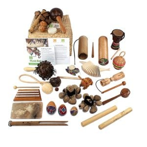 World Music Basket - Medium - 23 Instruments, with the contents laid out flat outside of the basket.
