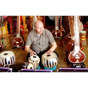 Image showing Andy Gleadhill playing Indian instruments