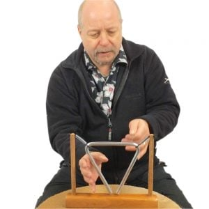 Image showing Andy Gleadhill holding a triangle instrument.