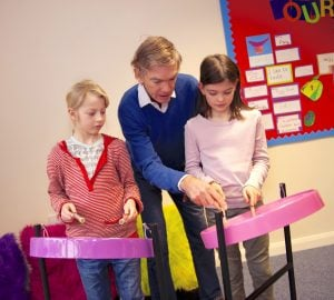 Image showing of Andy Gwatkin showing children how to play Caribbean Steel Pans