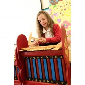 This is a product image of Drums for Schools Gamelan Budget Medium 7 key, played in action.