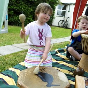 This is a product image of Drums for Schools' Shaman Drum 16in, 40cm diameter painted, played in action.