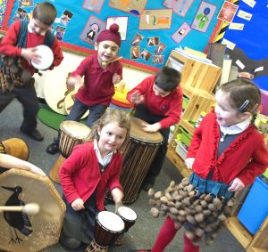 Action shot of preschool students play Drums for Schools' mix of intruments