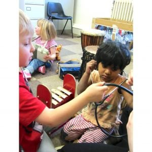 Action shot of students playing Drums for Schools' big stuff kit 14 instruments