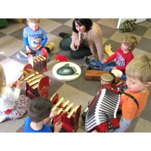 Action shot of students playing Drums for Schools' big stuff kit 14 instruments with accordion