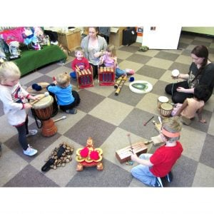Image of children playing Drums for Schools' big stuff kit 14 instruments in circle