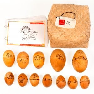 This is a product image of Drums for Schools Egg Basket with contents laid out flat outside of the basket.
