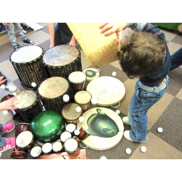 Action shot of 100 ping pong balls being played with Drums for Schools' instruments