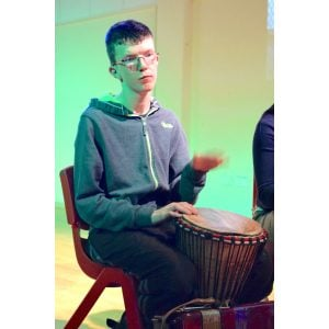 Image of Special Education Need student playing djembe