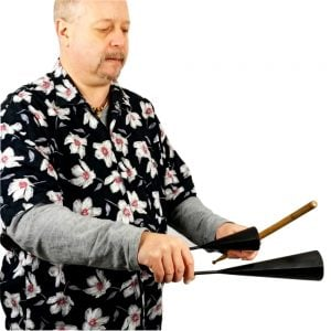 Image of Andy Gleadhil demonstrating how to play Agogo Bells