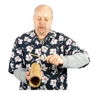 Image of Andy Gleadhil demonstrating how to play Guiro Bamboo
