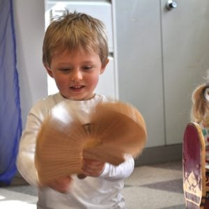 Image of an Early Year student playing Drums for Schools' Long Clacker