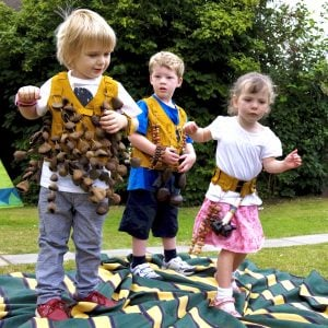 Image of preschool students playing with Drums for Schools' music tunic and music belt