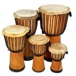 This is product image of Drums for Schools' Set of Standard Djembe Natural 30, 40, 50, 60, and 65cm. Image is showing the drums grouped tight