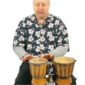 Image showing Andy Gleadhill playing african bongos.