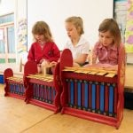 This is a product image of Drums for Schools Set of Gamelan Budget 7 key - Small, Medium, Large. Played in action.